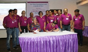Pat and Friends of Max Trustees signing partnership agreement.